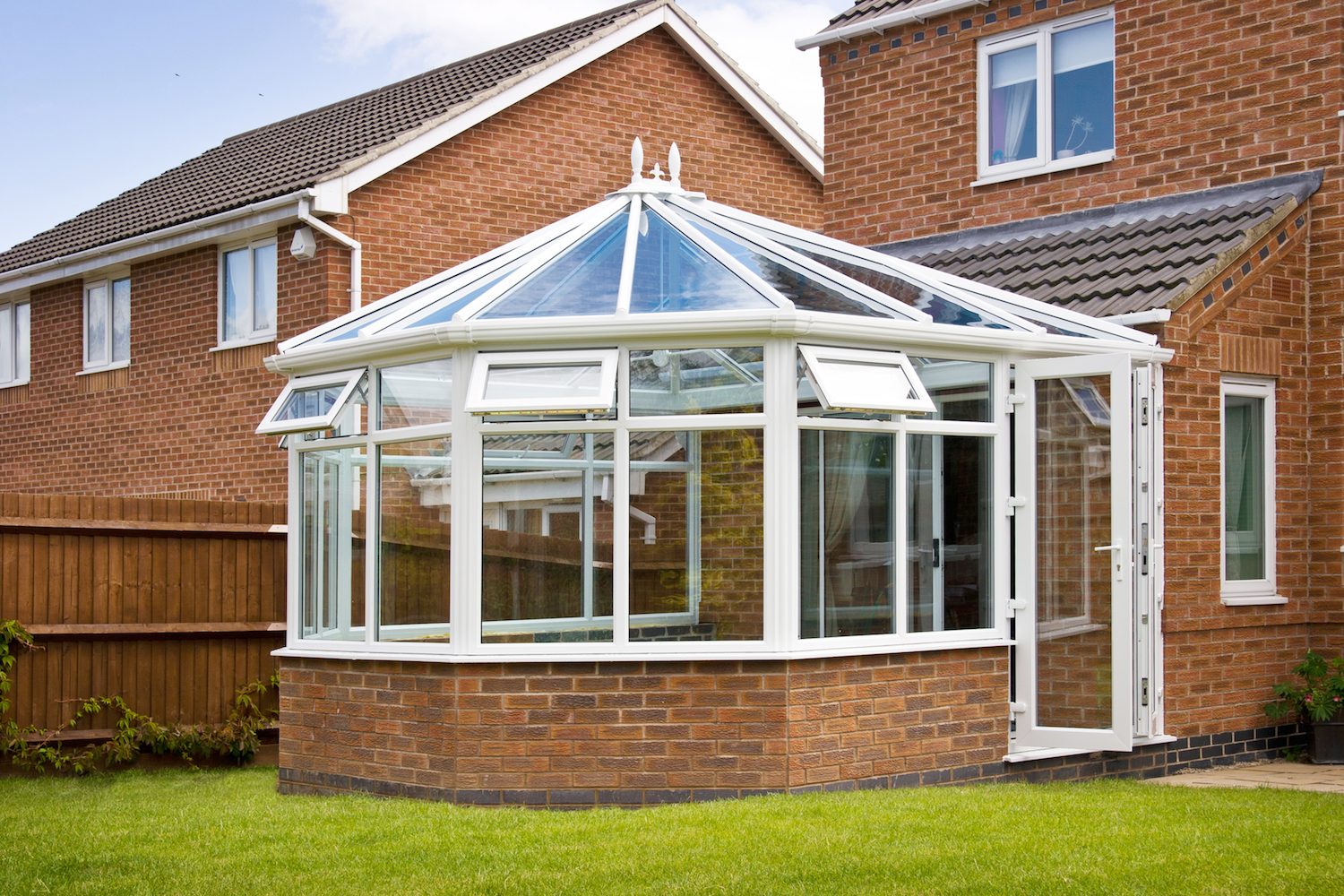 White-framed glass conservatory attached to house